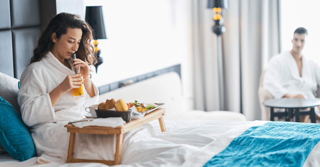 Couple enjoying room service
